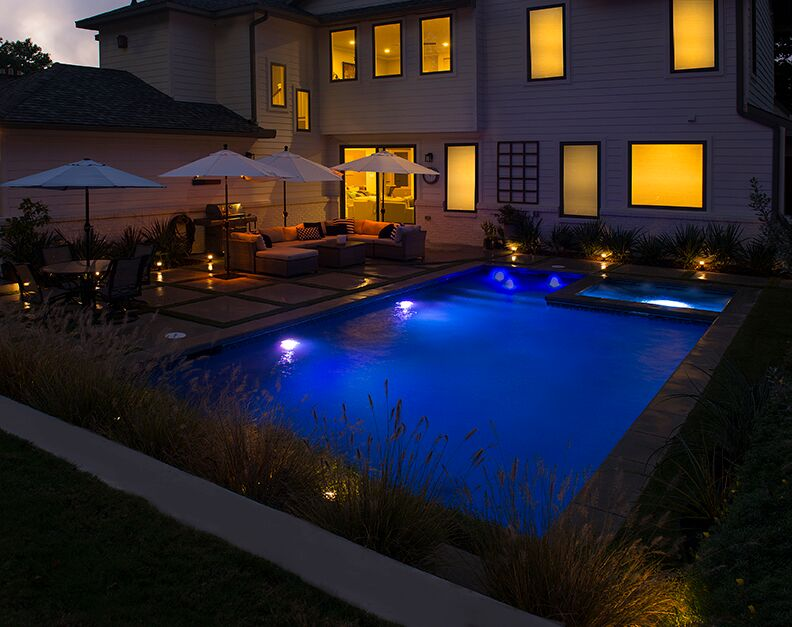 The Bellewood Drive Job located in Dallas TX. This is a night shot of the pool which showcases the brilliant LED Pool Light Technology.