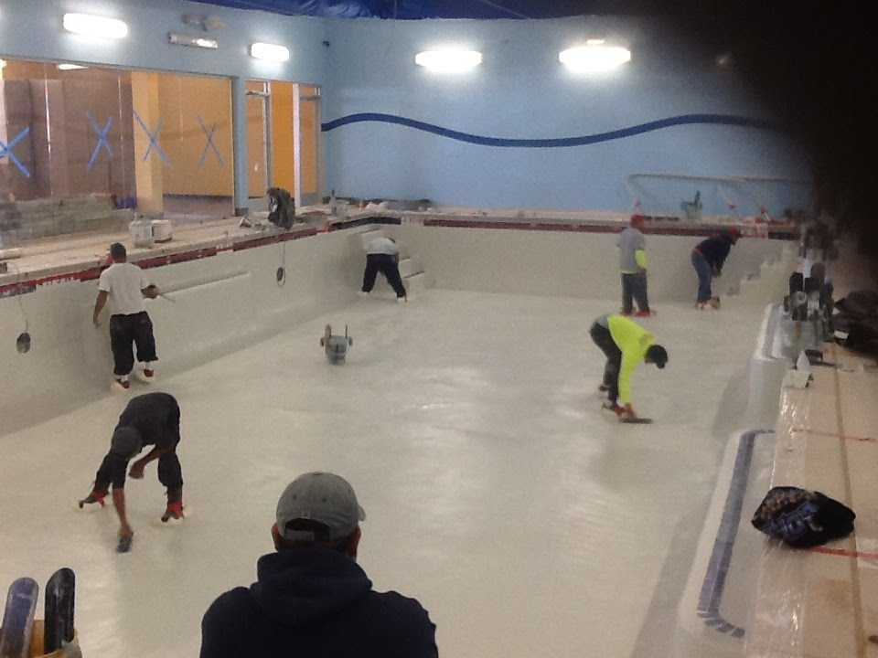 Summerhill Pools constructing a new Aqua Tots Swimming School. Plaster is being applied to the freshly constructed gunite shell.